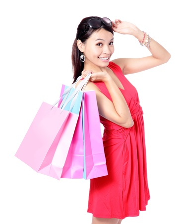 young asian girl: lovely woman take shopping bags with happy smile face isolated over white background, model is a asian girl
