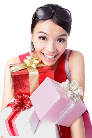 happy woman take big gift with smile isolated over white background, model is a asian girl photo