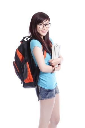 estudiante de secundaria: Joven estudiante de ni�a feliz holdng libro y una sonrisa aislados en fondo blanco, modelo es una mujer asi�tica Foto de archivo
