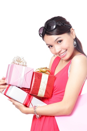woman happy take gifts with smile isolated over white background, model is a asian girl photo