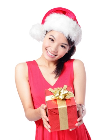 Santa girl holding christmas gift. Young happy woman in santa hat showing Christmas present isolated on white background. model is a asian girl Stock Photo - 15075522