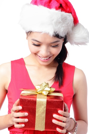 close up of young santa girl smile and happy look Christmas gift isolated on white background, model is a asian woman photo