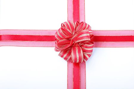 Gift red ribbon and bow isolated on white background photo