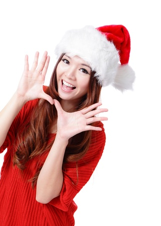 hi hat: Happy Christmas woman excited say hello isolated on white background wearing red Santa hat. Beautiful Asian model.