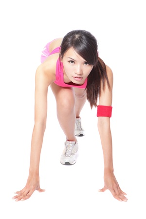 start position: Female athlete woman in position ready to run - isolated over a white background, model is a asian girl