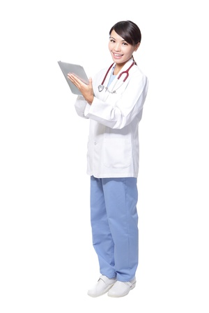 surgeon woman doctor using tablet pc in full length and smile to the camera isolated on white background, model is a asian beauty photo