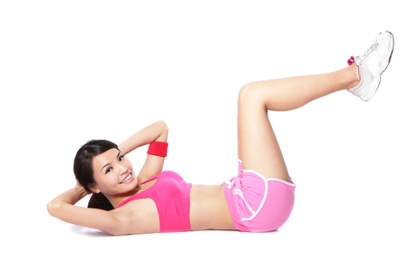 abdominal muscles: Exercise woman doing situps workout training in full length isolated on white background. Asian sport fitness woman smiling cheerful and happy looking at camera