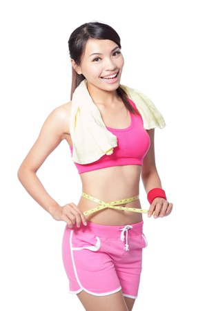 Woman measuring shape of beautiful waist with smile after sport for Healthy lifestyles concept isolated on white background, model is a asian beauty