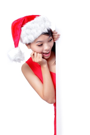 christmas young girl showing blank billboard banner sign smiling happy looking at camera. Beautiful and cute Asian female model photo