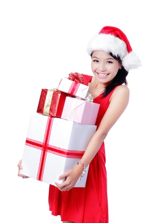 Young happy girl in Christmas hat holding huge christmas gift isolated on white background Stock Photo - 15557044