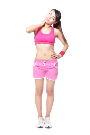 beautiful young sport woman touching her shoulder in full length, isolated against white background, model is a asian girl photo