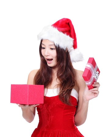 beautiful Christmas Woman happy open gift box with surprise face isolated on white background, model is a asian girl photo