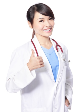 attractive female doctor woman show thumbs up hand sign isolated on white background, model is a asian woman photo
