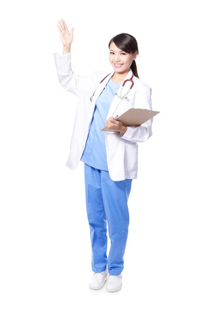 medical doctor woman smile with stethoscope hand showing something on the open palm, concept of advertisement product, empty copy space. Isolated over white background, asian female model Stock Photo - 15762591