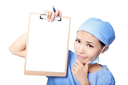 Young woman doctor or nurse thinking showing empty blank clipboard with copy space for text isolated over white background. asian female model photo