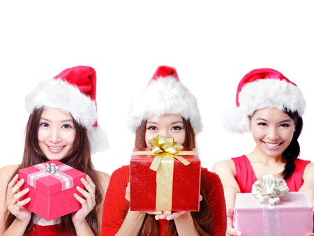 Three happy Christmas girls holding christmas gift isolated on white background photo