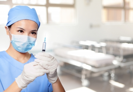 injection woman: surgery woman doctor holding syringe needle in hospital, asian female model