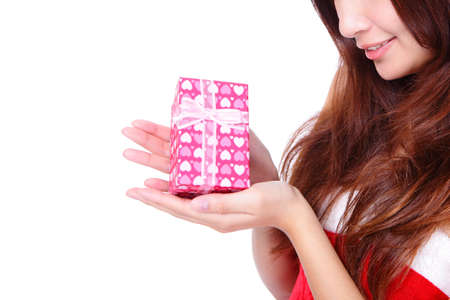 Close up on hand presenting gift box and smiling christmas woman isolated on white background, asian beauty model photo