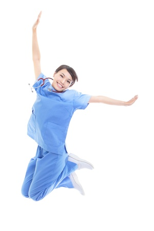 air jump: Excited young female doctor or nurse happy jumping high isolated on white background, model is a asian woman