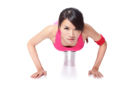 gym girl: Attractive Young sport Woman Doing Push Up Exercise in full length isolated on white background, mode is a asian girl