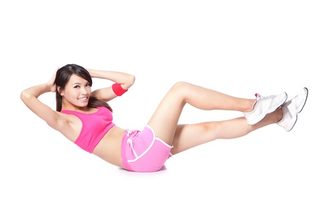 asian abs: Exercise sport woman doing situps workout training in full length isolated on white background. Asian sport fitness woman smiling cheerful and happy looking at camera Stock Photo