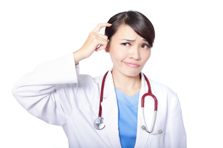 medical doctor woman think looking up to empty copy space with stethoscope, nurse wear blue surgery suit. Isolated over white background, asian female model photo