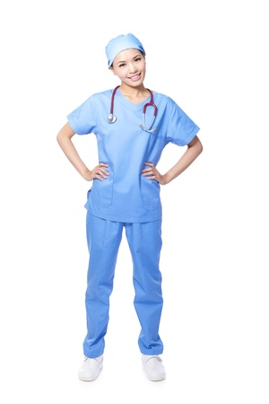 Young female surgeon doctor or nurse full length portrait isolated on white background, model is a asian woman photo