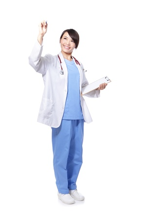 Successful smiling female doctor touching on something in the air in full length isolated on white background, model is a asian woman