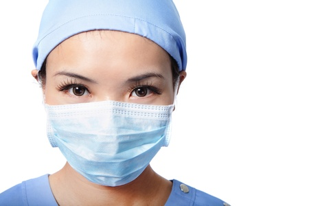 surgical mask woman: Close up portrait of serious woman nurse or doctor face in surgical mask isolated on white background, model is a asian female