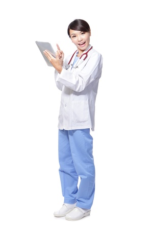 Young woman doctor happy using tablet pc computer in full length isolated on white background, model is a asian female Stock Photo - 16487789