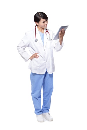 doctor stress: Woman Doctor look tablet pc with confuse face in full length isolated on white background, model is a asian female