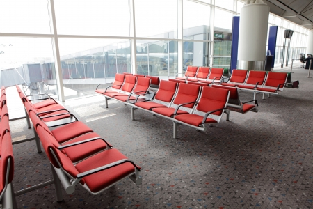 waiting area in the airport gate, row of red chair at airport, shot in asia, hongkong photo