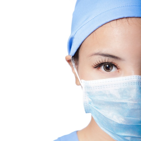 halves: Half Close up portrait of serious woman nurse or doctor face in surgical mask isolated on white background, model is a asian female