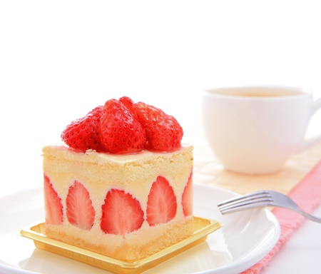 Dessert - sweet cake with strawberry on a plate with white copy space photo