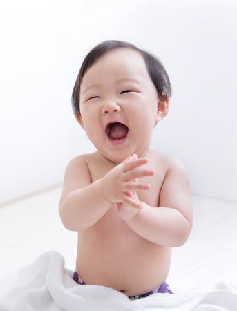 Excited cute girl Baby smile face and sitting on bed at home, asian child Zdjęcie Seryjne