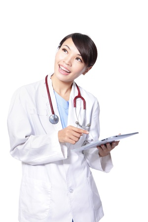 surgeon woman doctor smile using tablet pc and look to empty copy space isolated on white background, model is a asian beauty Stock Photo - 16661220