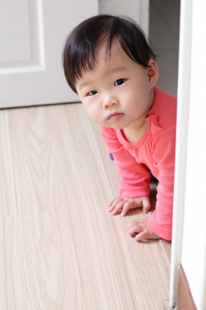 crawling girl baby on living room floor, asian child photo