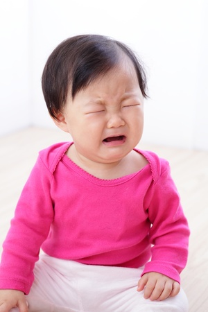 portrait of crying baby girl on living room at home, asian child Stock Photo - 16686203
