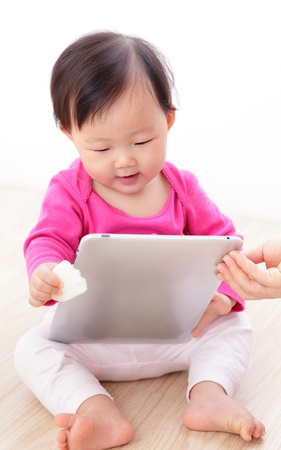 Girl baby happy play game with tablet PC. asian child smile photo