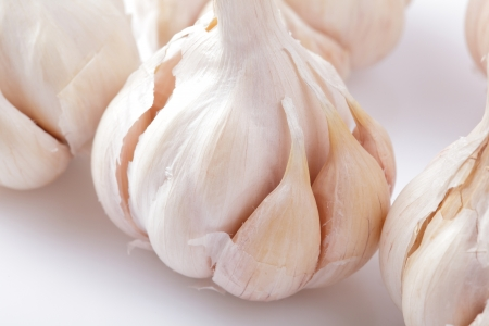 Fresh garlic close up on kitchen table photo