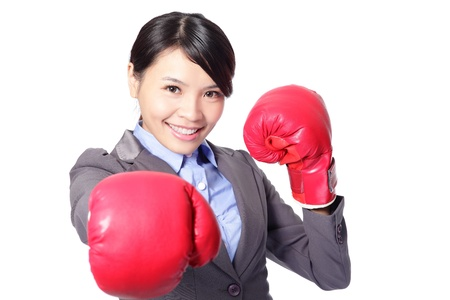 young attractive business woman with boxing gloves are ready for battle, punching towards camera isolated on white background, beautiful asian female model Stock Photo - 16758839