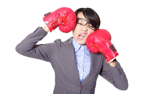 loser: Funny businesswoman wearing boxing gloves and knock down itself, defeated loser woman