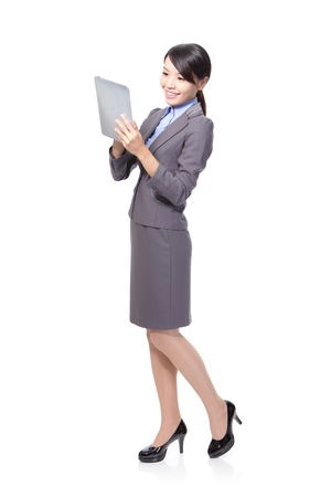 woman in suit: Beautiful Business woman happy using tablet PC in full length isolated on white background. young Asian woman model