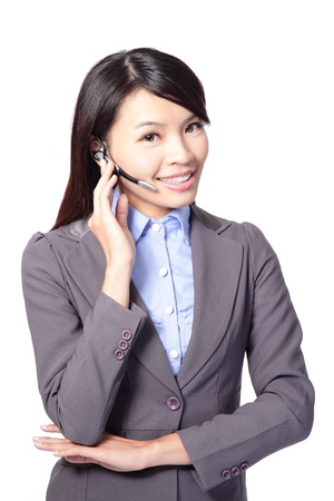 Female customer support operator with headset and smiling isolated on white background, asian woman photo