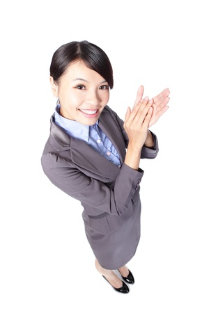 ovation: Happy business woman applauding in full length isolated over a white background, high angle view, asian beauty model