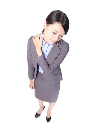 shoulder problem: Young business woman overwork and suffering from neck and shoulder pain in full length isolated over a white background, high angle view, asian beauty model Stock Photo