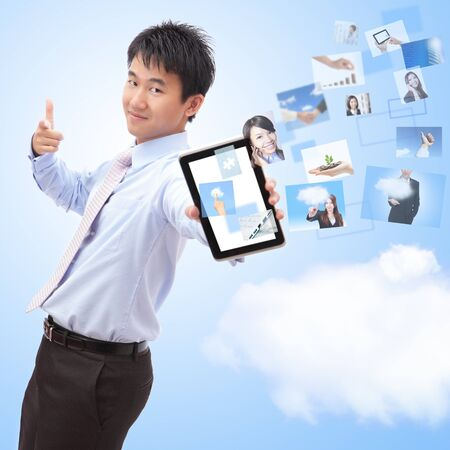 business man shows touch screen tablet pc with streaming images, concept for business and cloud computing, asian man model Stock Photo - 16826619