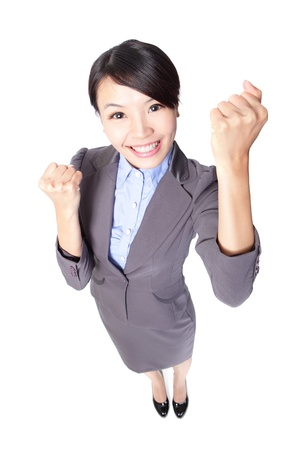 Happy Success winner business woman celebrating with her arms up and show fist in full length isolated over a white background, high angle view, asian beauty model Stock Photo - 16826616