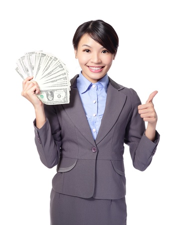 woman holding money: Excited business woman with handful of money giving thumbs up isolated on white background, asian beauty model Stock Photo