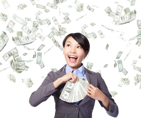 happy business woman with earned dollar bills us money in suit pocket under a money rain photo
